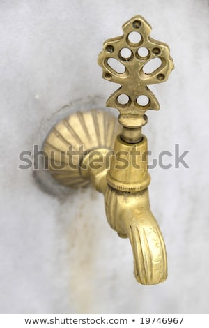 Old and used Vintage faucet with water drop Stock photo © Klinker