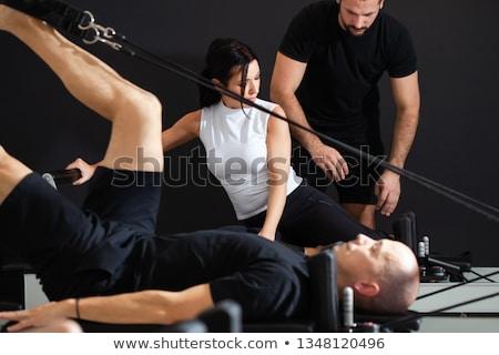 Pilates reformer woman tower exercise Stock photo © lunamarina