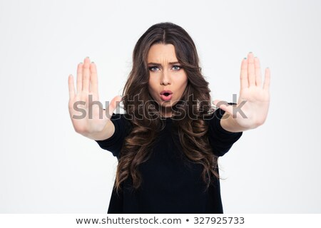 Beautiful girl showing stop sign with palms Stock photo © deandrobot