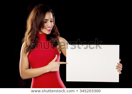 woman in red dress holding blank board stock photo © deandrobot