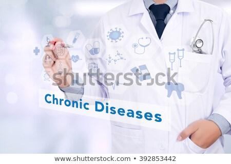 chronic diseases medical concept on red background stock photo © tashatuvango