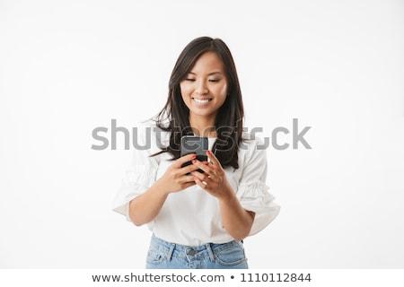 Uśmiechnięty przepiękny młoda kobieta długo ciemne włosy Zdjęcia stock © deandrobot