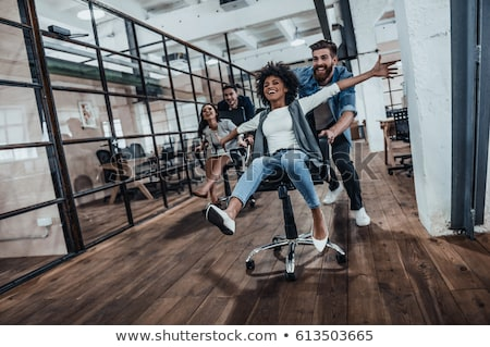 Young business happy excited winner woman at office celebrating Stock photo © zurijeta
