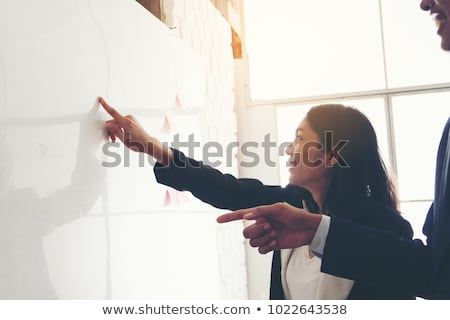 businesswoman pointing finger on blank board stock photo © deandrobot