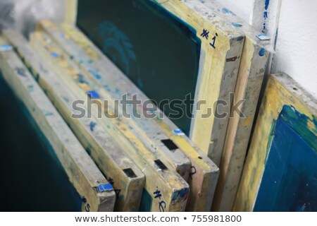 Stock photo: stack of picture frames in printing shop
