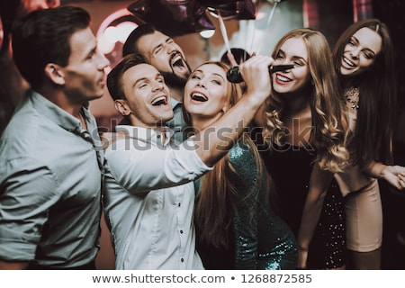 Karaoke örnek kız televizyon mikrofon ekran Stok fotoğraf © adrenalina