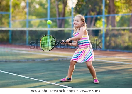 a caucasian girl playing tennis stock photo © bluering