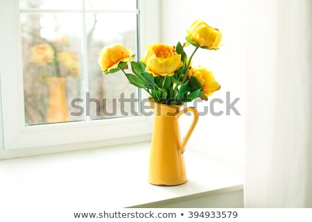 Flowers in a yellow vase Stock photo © bluering