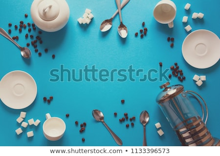 sugar bowl and saucer with spoon on table Stock photo © dolgachov