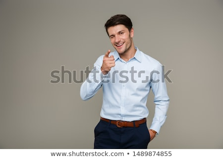 portrait of smiling brunette man pointing finger at camera stock photo © deandrobot