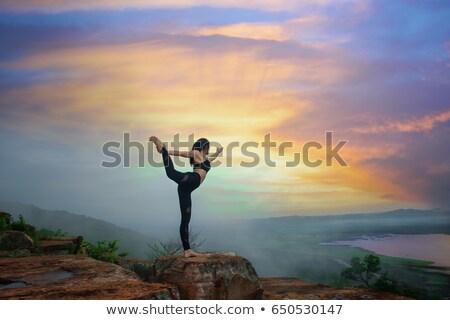 fiatal · nő · ül · felső · hegy · néz · természet - stock fotó © yatsenko