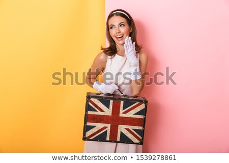 pretty young pin up girl in yellow dress stock photo © deandrobot