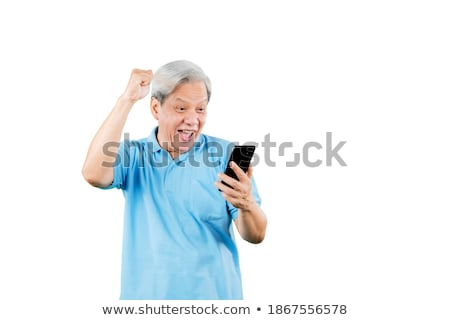 excited casual man reading good news on his smartphone  Stock photo © feedough