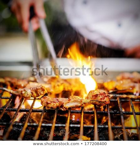chef bbq grilled pork ribs on smoke stock photo © smuki