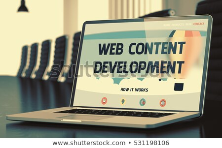 Web Development on Laptop in Conference Hall. 3D. Stock photo © tashatuvango