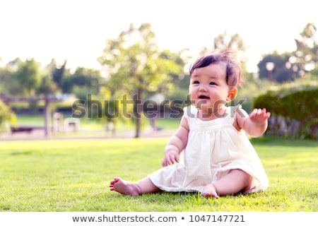 little girl crawling on the lawn Stock photo © tekso