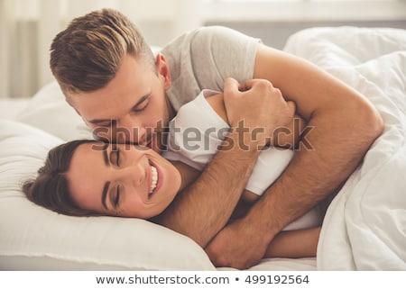 liefde · paar · knuffelen · home · woonkamer - stockfoto © monkey_business