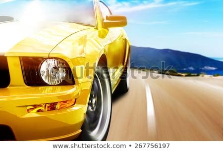 Сток-фото: A Yellow Car On The Highway