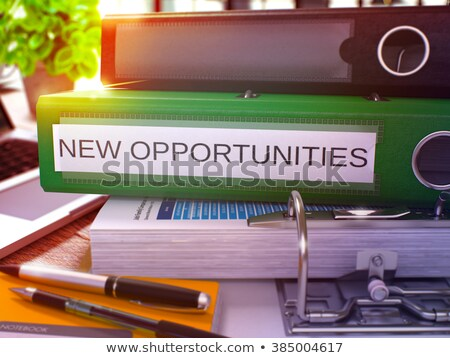 Green Office Folder with Inscription New Opportunities. Stock photo © tashatuvango