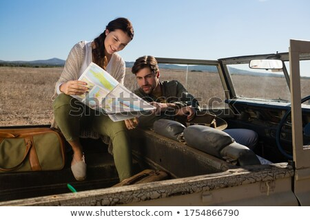 Couple reading map in off road vehicle Stock photo © wavebreak_media