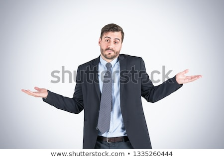 Confused caucasian businessman shrugging shoulders Stock photo © RAStudio