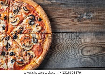 Pepperoni funghi pizza fatto in casa olive nere prosciutto Foto d'archivio © zhekos
