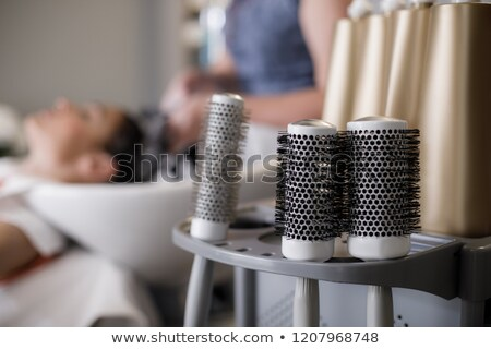 woman at sink at hairdressers Stock photo © IS2