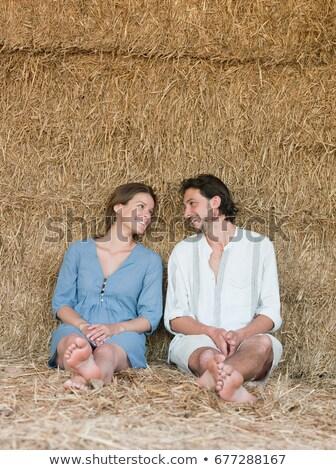 Homem mulher sessão feno fardo amor Foto stock © IS2