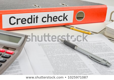 Stock photo: An orange folder with the label Credit check