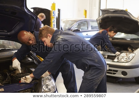 Teacher helping student with car engine Stock photo © IS2