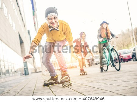 Trendy girls with skateboard and rollers Stock photo © dash