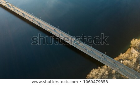 Kiev, Ukraine view from above on the North Bridge with passing cars through the Dnieper River, photo Stock photo © artjazz