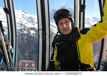 érett férfi kék sí mosolyog ül kint Stock fotó © IS2