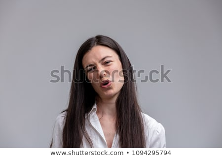 Scornful attractive woman talking to the camera Stock photo © Giulio_Fornasar