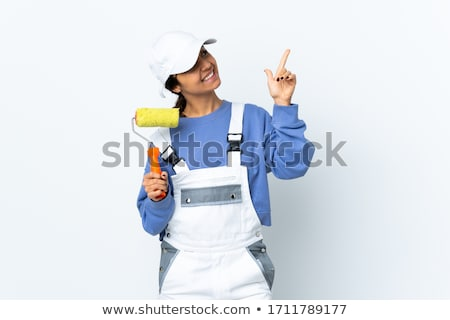 Happy female painter pointing with brush  Stock photo © dash