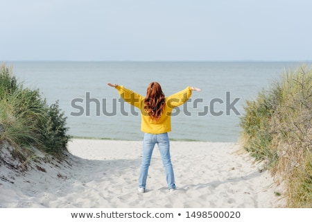 Rear View Of A Woman Outstretching Her Arms Stock photo © AndreyPopov