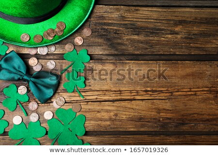 gold coins with shamrock on wooden table stock photo © dolgachov