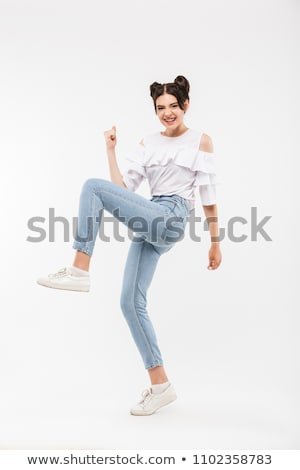 Full length photo of amusing cheerful girl 20s with double buns  Stock photo © deandrobot