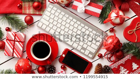 Christmas presents and decorations around gadgets and beverage Stock photo © dash