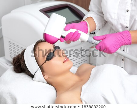 Doctor Waxing Woman's Forehead Stock photo © AndreyPopov