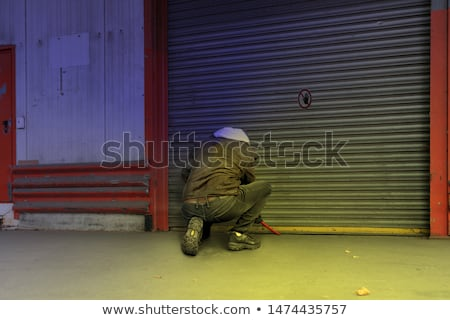Thief Trying To Break The Door With Crowbar Stock photo © AndreyPopov