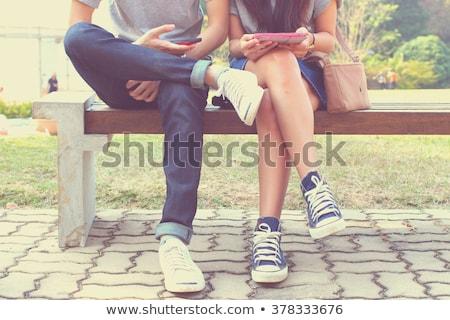 кавказский женщину сидят улице мобильного телефона Сток-фото © deandrobot