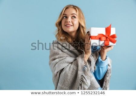 Image of joyful woman 20s wrapped in blanket holding present box Stock photo © deandrobot