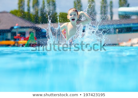 happy boy kid jumping in the pool Stock photo © galitskaya