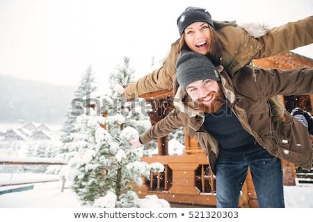 Stok fotoğraf: Woman And Man Enjoying Winter In The Snow
