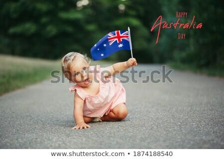 aussie girl waving a flag travel tourism australia stock photo © lovleah
