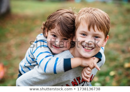 Portrait of two happy cheerful brothers at sunset, outdoor Stock photo © Lopolo