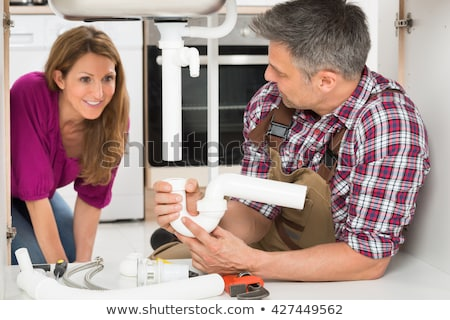 close up of male plumber showing damaged sink pipe stock photo © andreypopov