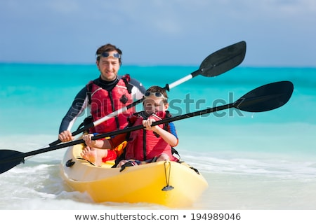 Apa fia kajakozás trópusi óceán égbolt víz Stock fotó © galitskaya