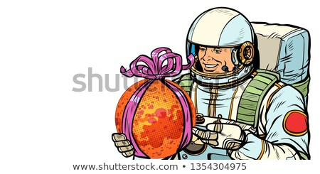 Astronaut gives the planet Mars. Isolate on white background Stock photo © studiostoks